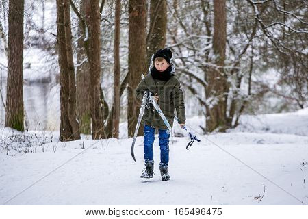 GRODNO BELARUS -JANUARY 15 : Boy skiing in the snowy winter forest JANUARY 15 2016 GRODNO BELARUS