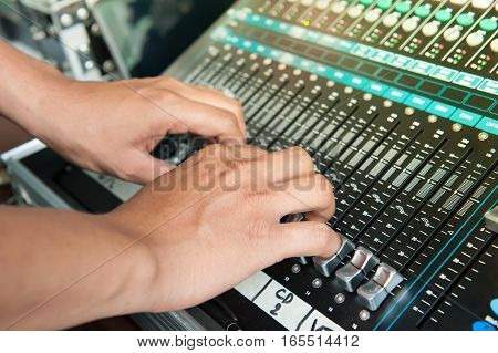 Hand Adjusting Volume Fader Of Digital Audio Mixer. Professional Sound Engineer Balancing Volume Of