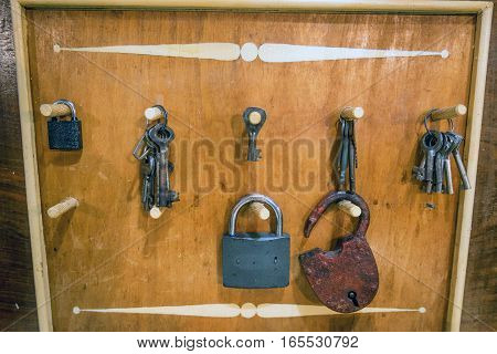 Various check-lock and different keys on wooden background