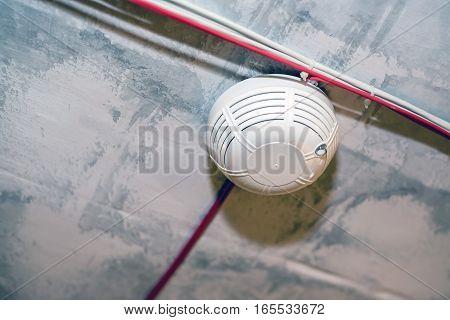 Close-up of smoke detecting sensor on a ceiling