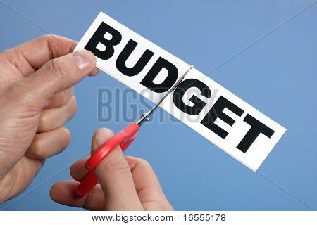 Scissors cutting the word budget concept for recession or credit crisis