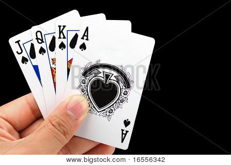 hand holding four playing card