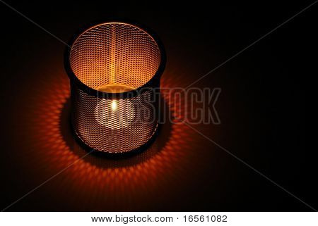 Candle in meshy container