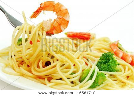 Fork with pasta and shrimp isolated on white