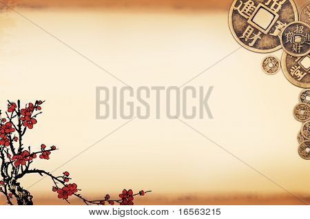 Traditional plum pattern and ancient copper coins on a vintage background,large copy space for your text.