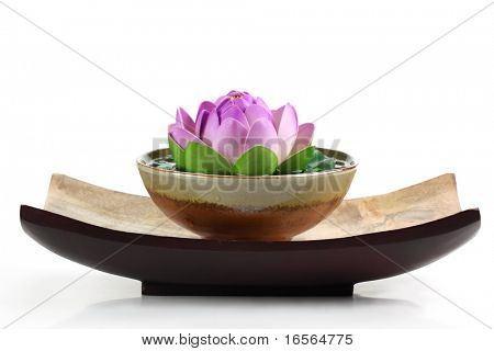 Spa objects with lotus flower and bowl