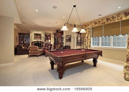Pool table and sitting area in rec room