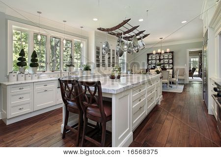 Kitchen in luxury home with white granite island