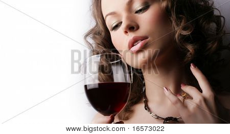 Portrait of beautiful woman with glass red wine on white background