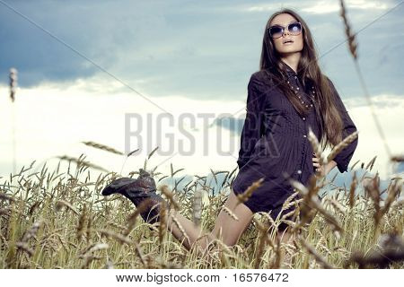 beautiful brunette girl at the field