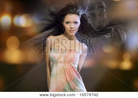 Portrait of a beautiful girl with flying black hair