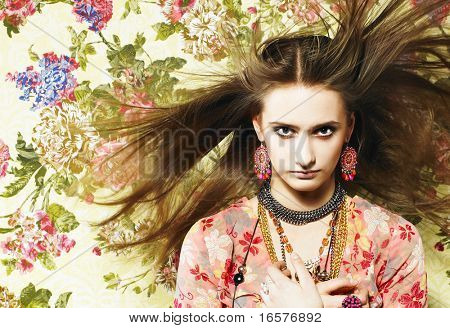 Pretty girl with bijouterie. Fashion photo. Beauty and style