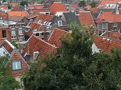 Panoramic View On A Medieval Old Town Showing Houses With  Red Roofs poster