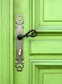 stock photo of door-handle  - light green door with metal handle - JPG
