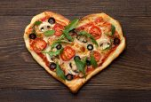 Homemade Pizza In Heart Shape With Chicken And Mushrooms On Rustic Wooden Table. poster