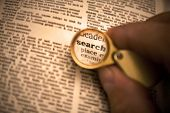 Dictionary definition of the word search in magnifying glass