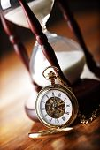 foto of sand timer  - Hour glass or sand timer with vintage pocket watch - JPG