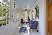 stock photo of screen-porch  - Porch with wall of windows and blue ceiling - JPG