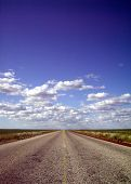 stock photo of campervan  - picture of never ending road with cloudy skies