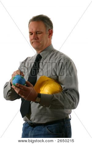 Engineer Examining The Earth