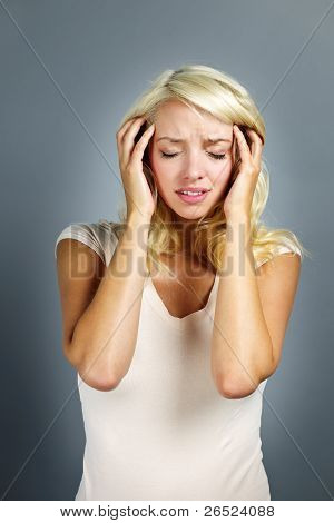 Unhappy Woman Holding Her Head