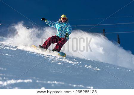 Fast Snowboarder Downhill At Ski