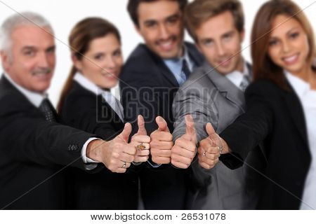 Manager and his team all giving a strong thumbs up