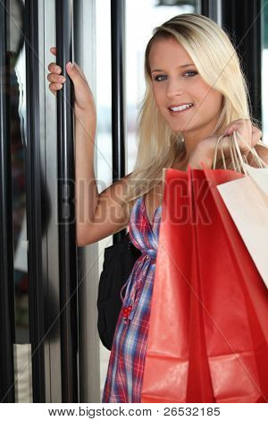 Young woman entering in a store
