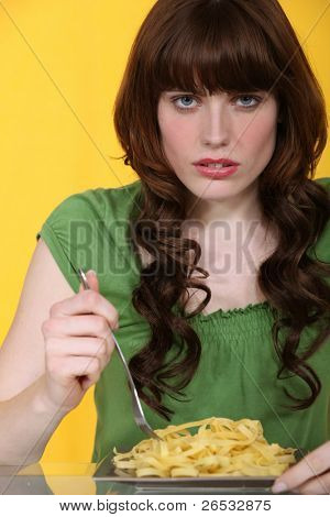 Woman eating plain tagliatelle
