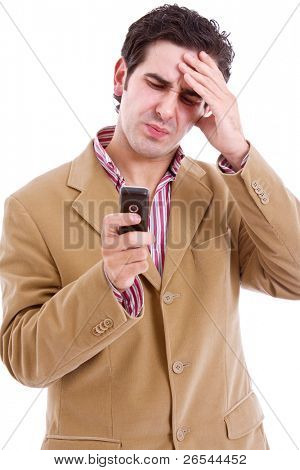 Businessman with bad news on his cell phone, isolated on white