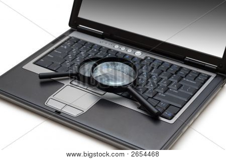 Computing Concept - Looking For Viruses On The Laptop