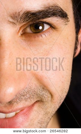Close up portrait of an young attractive man on a black background