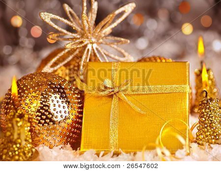 Golden Christmas Gift With Baubles Decorations And Candles