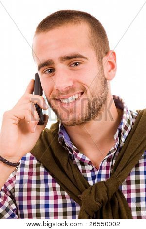 Happy young man using mobile phone, looking at camera and smiling, isolated on white