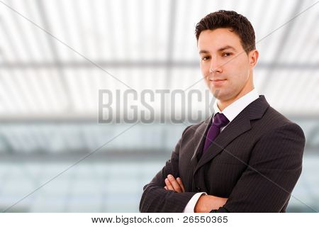 Portrait of a young successful business man at a modern office bulding