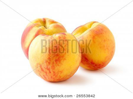 three peaches on a white background and with soft shadow