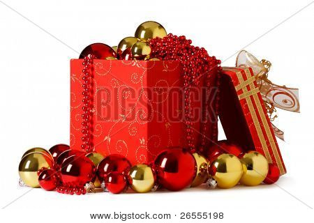 christmas present. Gift box and christmas baubles  on a white background