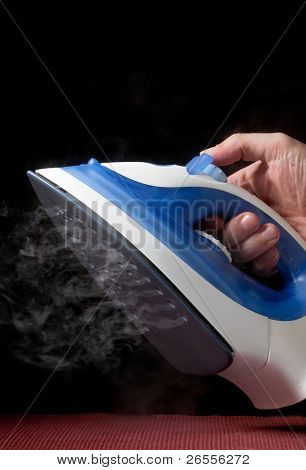 electric iron emitting steam