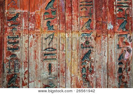 Ancient Egyptian hieroglyphs engraved in stone