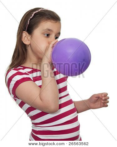Girl blowing a balloon isolated on white