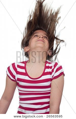 Young girl with her hair blowing in the air on a white background