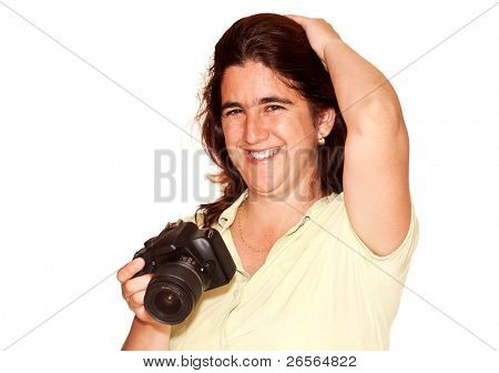 Woman smiling and holding a professional camera on a white background