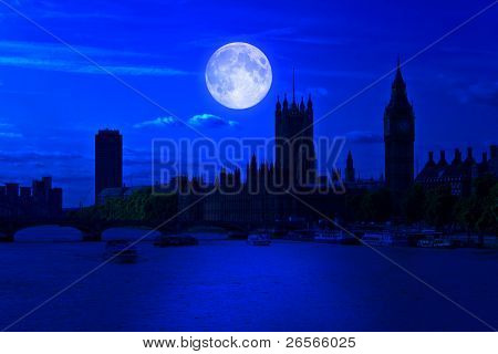 The Big Ben and the river Thames at midnight with a bright full moon