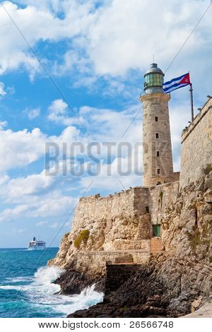 The castle of El Morro in Havana with a waving cuban flag