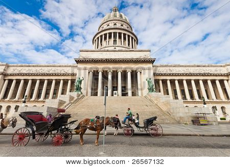 HAVANA-MARCH 14:Horse carriages wait for tourists in front of the Capitol May 14,2011 in Havana.Tourism attracts over 2 million people a year and is one of the main sources of revenue for Cuba