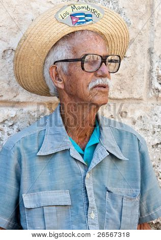 HAVANA-MARCH 25:Old man in typical clothes March 25, 2011 in Havana.People dressed in a way that represents the cuban nationality can still be found in the streets of Old Havana.