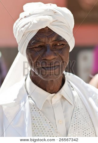 HAVANA-MARCH 25:Old black man with typical afrocuban clothes  March 25, 2011 in Havana.People dressed in a way that represents the cuban nationality can still be found in the streets of Old Havana