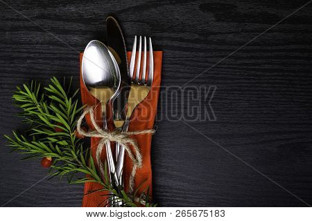 poster of Winter Holiday Dinner Plate Decoration On Black Wood Background. Table Set With A Winter, Christmas