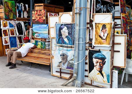 HAVANA-APRIL 2:Art market in Havana's old harbors April 2,2011 in Havana.One of Havana's tourist attractions,this fair sells paintings of iconic cuban themes and famous artistic or political figures