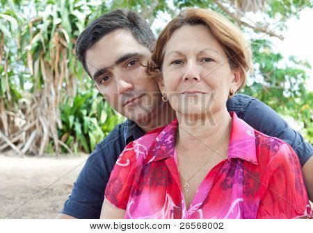 Latin man and older woman in a park